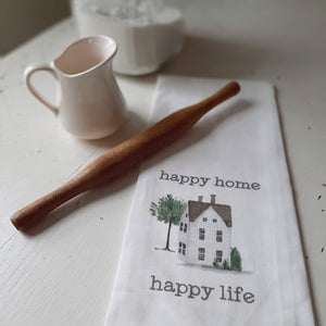 "Happy Home Happy Life Dish Towel is an inspirational dish towel with a printed farmhouse graphic. It is white and reads, ""happy home happy life"" in gray lettering.This 100% cotton towel is lightweight, durable, and super absorbent and looks darling hung for display. Measures 25.5"" high by 18"" wide."