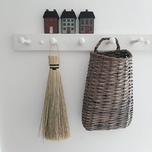 "These Dutch Village Houses make cheerful shelf accents. The small wooden houses are painted in country colors with chimneys and wreaths on their doors. Each also has an opening in the back for a hanging option. They measure 2"" wide by 3½"" tall. Set of three"