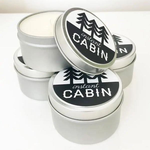 Life among the pines is easy to escape to when this Instant Cabin Scented Candle is glowing.  Scented with earthy amber, balsam and spices, the Instant Cabin candle makes the perfect gift for the city dweller who needs an escape. It makes every day feel like Christmastime. Made with 100% soy wax. 6oz Made in the USA