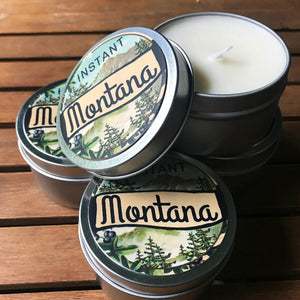 When you need a little Montana in your life... this Instant Montana Scented Candle creates an instant escape to a cozy cabin in the woods. Scented with a blend of pine and cardamom over a base of woody vanilla, you'll want to curl up with a blanket and a book when this candle is casting its warm glow. Made with 100% soy wax. 6oz Made in the USA