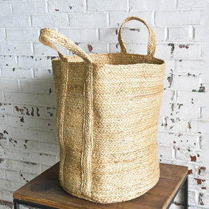 "Whether you're taking a trip to the beach or looking for style storage for blankets, towels, toys or knitting supplies, our Jumbo Jute Bag has you covered. Handwoven natural jute brings an organic feel to farmhouse style, and its earthy quality suits décor styles from modern to rustic. 14"" Diam x 20""H"