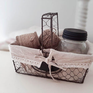 Our Linen and Lace Lined Wire Basket has tons of French Country farmhouse charm. The fabric lining, has a natural oatmeal color with cotton lace trim and is easily removed and machine washable. This functional wire basket creates stylish storage for any room in your farmhouse. The vintage feel makes it a perfect choice to display on shelves or buffet table. Jar, twine and decorative items not included.