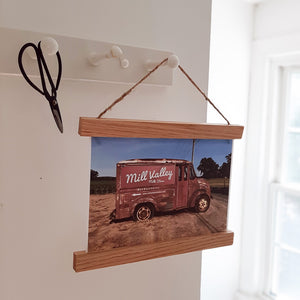 Turn your favorite photos or prints into instant wall art with our Magnetic Wood Poster Frame. The frames are handcrafted from high-quality oak hardwood. Each set includes four sticks, two that clamp the top of the canvas and two that clamp the bottom with magnets. Each Hanger Frame package includes all three string options: faux leather cord, brown jute twine, and white cotton twine.