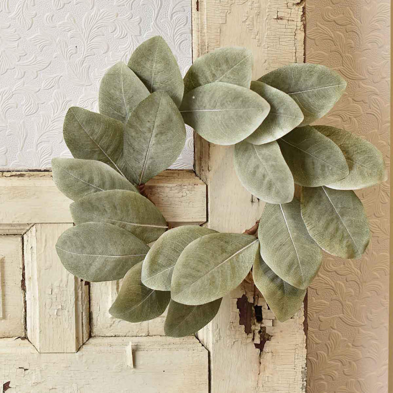 "The simple elegance of this Magnolia Leaf Wreath's design is tailor made for farmhouse style décor. It celebrates the beauty of nature. Each leaf brings forth its subtle mix of colors, including calming, soft grey-green. Let this faux Magnolia Leaf Wreath brighten any room in your farmhouse. 13"" in Diameter."