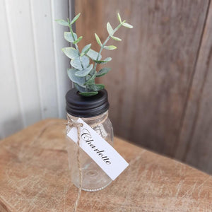 The vintage style clear glass bottle has a black metal twist-off lid that is specially designed to allow small florals to be displayed with ease, which pretty much makes them perfect for creating unique place cards for rustic style table settings or party favors. Set of 6