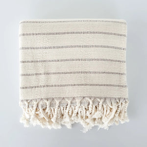 The Nantucket Stripes Turkish Towel lends a contemporary feel to any farmhouse bathroom.  Features a creamy white base with gray stripes and is made of Turkish cotton and bamboo.  The Nantucket Stripes bath towel is pre-washed and will become softer and more absorbent with each wash. The bath towels are larger than regular bath towels, dry quickly, and take up little space!   This Turkish towel is an all-purpose choice for indoor or outdoor use. Unlike thick, loopy terry towels, these flat-weave towels shak