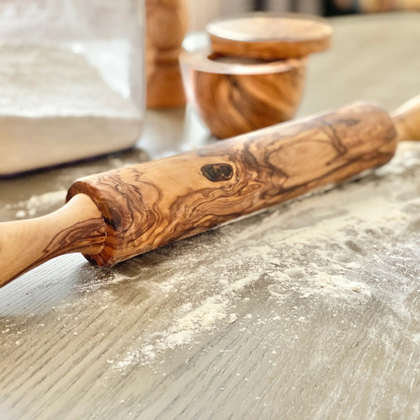 "Give your baking a rustic touch with our Olive Wood Rolling Pin. This beautifully crafted piece is perfect for rolling out cookie, pasta and pizza dough! Its great for all your baking needs. Olive wood is a hard wood making it very dense and durable for everyday use. Olive wood is nonporous so no germs or odors are retained. CARE INSTRUCTIONS: Hand wash and polish with food safe oil. 17""L"