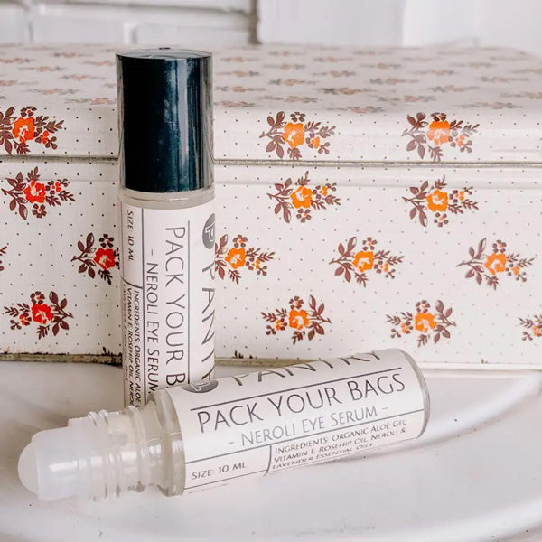 "This delightfully refreshing anti-aging roller ball contains organic aloe gel, rosehip oil and neroli and lavender essential oils which combine forces to calm under eye puffiness, banish bags, and smooth and reduce the appearance of smile crinkles (sounds better than ""crow's feet"", right?). Plus, it just feels darn good! Pack Your Bags Eye Serum is 3ml. Made in the USA"