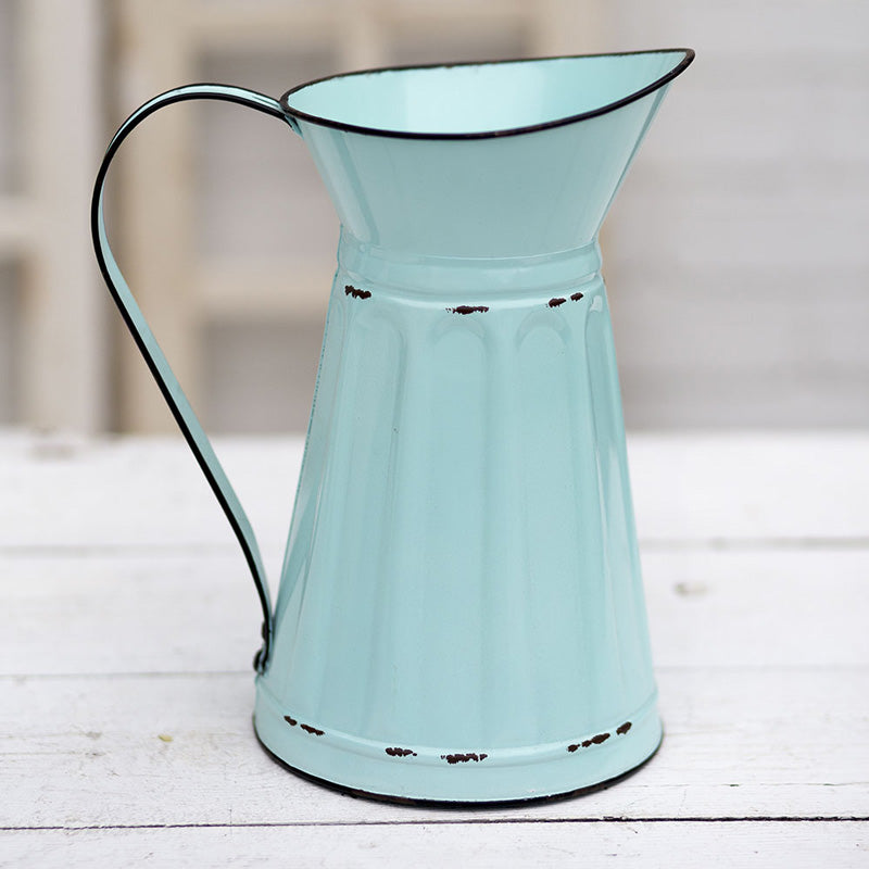 Our Pastel Blue Enamel Style Pitcher brings a nostalgic quality of simpler times and lazy summer days in the countryside. Its vintage style shape and aged chippy paint gives it a shabby chic farmhouse feel.