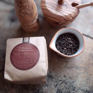 Tellicherry Peppercorns are left on the vine to ripen longer which lends to a milder, sweeter pepper flavor. Use these to refill our Olive Wood Pepper Mill grinder or your own special grinder. Single sourced and non-GMO. 10oz