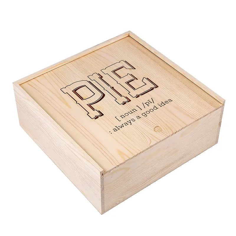 "Keep your pies warm and cozy with our Wood Pie Box. You'll add a bit of whimsy to your kitchen bakery with this pine box, featuring a sliding top with vintage style wood burned PIE graphic text. It's perfect for all of your homemade treats and makes a beautiful housewarming gift. 11.25""L x 11.25""W x 4.25""H"