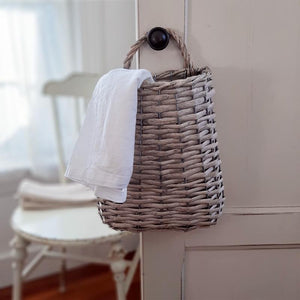 With a bit of old French country charm and simplicity, our Plymouth Wall Basket, Small is a farmhouse accent that has plenty of practicality. Store long serving utensils or let it overflow with your favorite dried flowers. No matter what you choose to stash away in this primitive style basket, it will look right at home in your farmhouse.