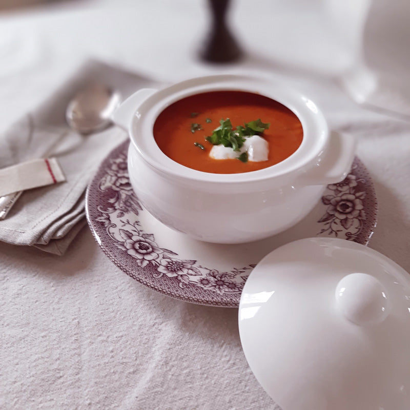 Serve up cobblers, stews, soups, casseroles and more in style with our Small Porcelain Baking Pot. Craft individual servings and create an elegant presentation. This mini round cocotte features a lid to ensure your dishes stay warm as you dazzle your guests with a stunning setting. Crafted in England, this Porcelain baking dish with cover features thick sides and bottom allowing for excellent heat retention.