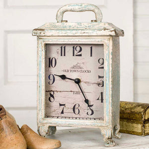 The Portsmouth Carriage Clock features a shabby chic aged patina and an elegant design, reminiscent of 19th century style.