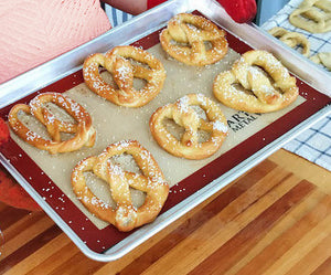 Soft pretzels are a deliciously salty, savory treat that taste even better when you make them yourself. Bring the best part of the brewpub home with this convenient little bag. Dusted with crunchy salt, these indulgent classics are the ultimate DIY kitchen project. Contains: Baking Mix, Baking Yeast, Malt Powder, Pretzel Salt.  Makes a dozen deliciously salty and savory treats.  Soft Pretzel Baking Mix