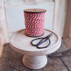 "This Red and White Thread with Wood Spool is vintage and versatile. Use this chunky baker style thread spool as a festive accent packed in baskets or bowls or put the red and white thread to use on gifts and more. The wood spools are reusable for twining  or as decorative accessories themselves!  Wood Spool is 3.5"" Diam x 4""H with 50 yards of thread"