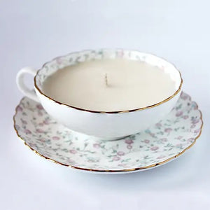Create a cottage retreat with our Rice Flower Teacup Candle.  Soy candle hand poured in a fine bone china teacup. Scalloped edges are delicately detailed with gold. The Rice Flower Teacup Candle burns for 20-25 hours and the soy wax washes out easily with soap and hot water afterwards, leaving you with a lovely keepsake cup and saucer set. This finely hand-poured candle is made with a blend of 100% pure soy wax & botanical oils, with a cotton wick.