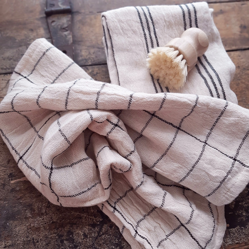 "Our Rustic Cotton Kitchen Towel Set is perfect for everyday farmhouse living. The super soft cotton and natural weave with black stripes gives these towels an earthy, relaxed quality. Features a hoop for hanging. 100% Cotton. Machine Wash Cold, Gentle Cycle, Tumble Dry Low. 28""L x 28.5""H"