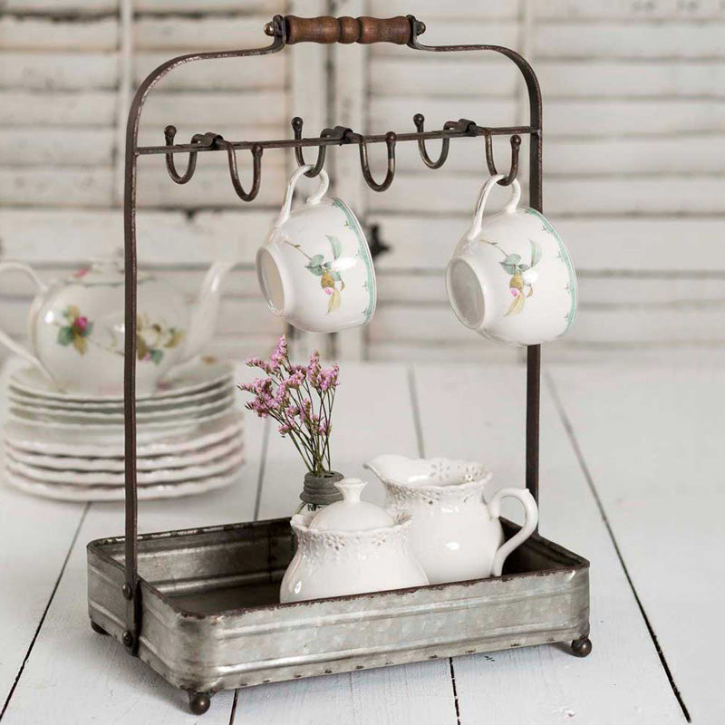 Create a cozy coffee bar in your farmhouse kitchen with our Rustic Metal Counter Caddy. This galvanized vintage style counter display holds six coffee cups and the base is perfect for stashing away small plates or as a k-cup coffee holder.