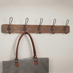 "Our Rustic Wood Coat Rack with Vintage Wire Hooks is perfect for farmhouse living. The rustic character of the wood makes each piece unique. The vintage style wire hooks are inspired by antique hooks found in old schoolhouse coat rooms. Whether your style is country farmhouse or vintage industrial, this coat rack's simple design will be at home in any mudroom, kitchen or bedroom. 26""L x 5.25""H"