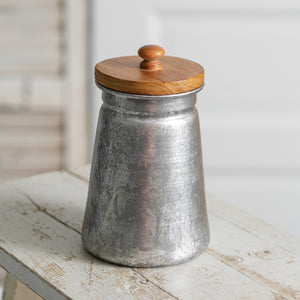 Add down-to-earth charm with our Rustic Metal Container with Wood Lid. This container offers farmhouse style storage and is great for displaying dried flowers or other small accessories. Not food safe. 4¼'' dia. x 7¼''H