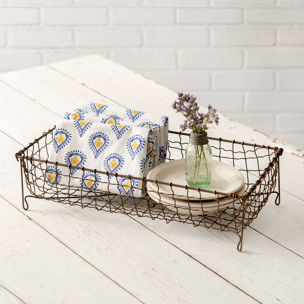 Wire baskets add instant farmhouse style to any room. This Rustic Footed Wire Basket is perfect for storing bathroom essentials or use it to hold napkins while entertaining with vintage style.