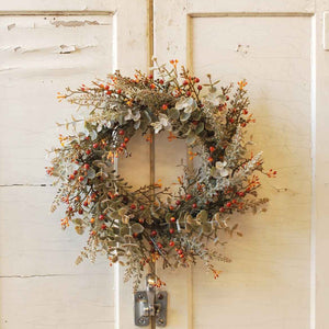 This Rusty Berries and  Eucalyptus Wreath and Candle Ring is bursting with farmhouse style charm.  Hang this sweet wreath, with its faux eucalyptus leaves and orange berries on the wall or use it with a candle to create a farm table centerpiece that will look beautiful in any season.