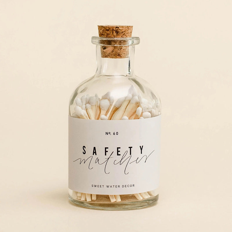 "These stylish safety matches, in a sweet apothecary style jar, are the perfect complement to any space. Modern, chic, and vintage in design, they are perfect for any room - from your bedroom, to living room, bathroom and more. They make the perfect gift alongside our Candle Care Kit and candles.  Details:  Color: White 2"" Match Sticks  Approximately 60 Matches Per Jar + Safety Matches Strike Match on Strike Pad on Jar to Light  Glass Jar Size: 3.5 x 1.5 x 1.5"""