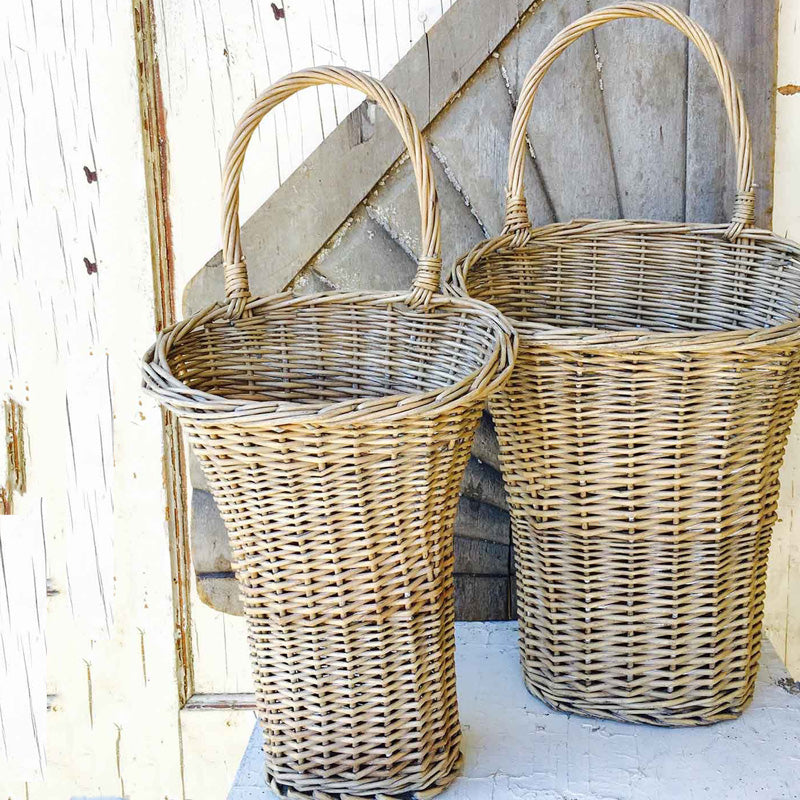 This Set of Two Willow Wall Baskets sets the tone every season for eye-catching farmhouse style. So perfect for changing up your farmhouse décor by simply switching out greenery and flowers with each new time of year. Features a grey wash weathered finish for a timeworn feel.