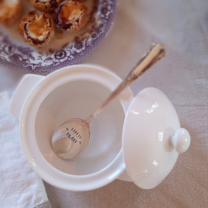 "So sweet! So vintage! Darling soup spoons are hand-stamped ""YOU""RE SOUPER"". Made from vintage silver plate spoons, each item will be unique. Due to their vintage nature, flatware pieces may show signs of age and gentle use. No two are alike and the handle will vary. The spoons are all lovingly collected by the artist from flea markets and antique shops and then hand-stamped with care. Includes one spoon. Each approximately 6""L. Made in the USA."