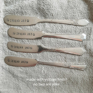 "So sweet! So vintage! A great way to start each day, each butter knife is hand-stamped ""spread joy"" with little smiley faces. Made from vintage silver plate butter knifes, each item will be unique. Due to their vintage nature, flatware pieces may show signs of age and gentle use. No two are alike and the handle will vary. The knives are all lovingly collected by the artist from flea markets and antique shops and then hand-stamped with care. Includes one knife. Each approximately 6.25""L. Made in the USA."