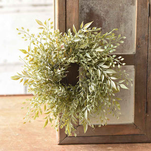 "Add a touch of elegance, no matter the season, with our Sweet Greens Wreath and Candle Ring. Perfect for adding a rustic boho twist to pillar candles and hurricanes, this earthy green provides fresh farmhouse charm all year long. 12"" Diam with 3"" Diam Inner"