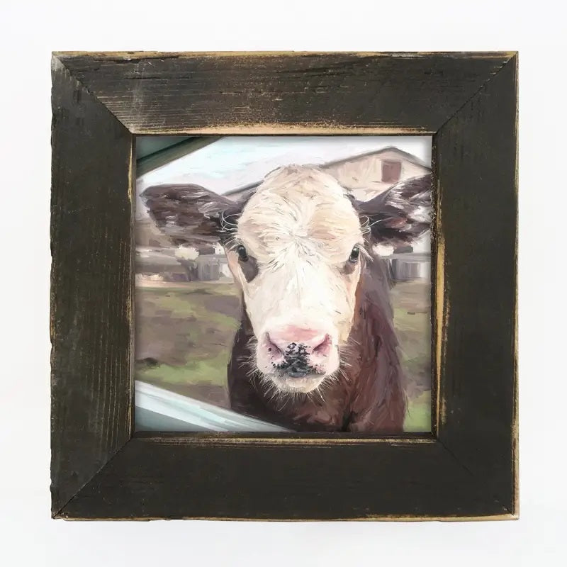 "Let this Sweet Baby Cow Wall Art brighten your farmhouse decor. There's something grounding and peaceful about these farm animals, and this girl's lovable face will surely add cheer to any room.The aged black frame is made of barnwood reclaimed from centuries-old wood from upstate NY. The artwork is printed on high-quality matte paper with archival inks and mounted permanently to 1/8"" hardboard which is mounted to the frame.Made in the USA . 8"" x 8"""