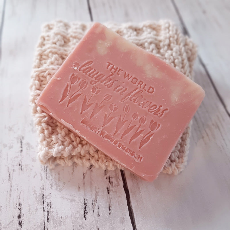 "This The World Laughs in Flowers Soap Bar makes a sweet addition to your spring and summer home. Let fresh cheerful citrus scent put a smile on your heart while keeping your hands clean. Made with all-natural skin loving ingredients in the USA. 4.5oz. 3.5"" l x 1"" w x 2.5"" h"