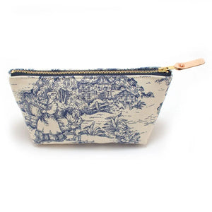As Seen in Country Living  The Vintage Toile Travel Clutch gives timeless blue and cream toile fabric a functional twist.  The Vintage Toile Travel Clutch has so many uses. Turn it into your makeup bag and store brushes and cosmetics, keep sewing tools and scissors ready to go on your next trip, or keep it by your journal packed you're your favorite writing utensils.