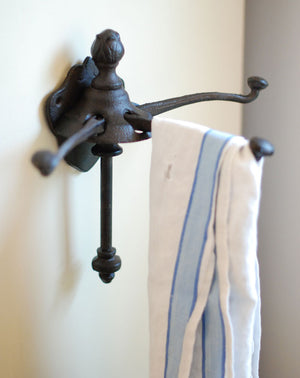 Our Vintage Folding Wall Hook is made of sturdy cast iron and offers unique style to any room. Perfect for hanging dishtowels, scarves, necklaces and more, this antique reproduction features three hooks that can also be folded up when not in use.