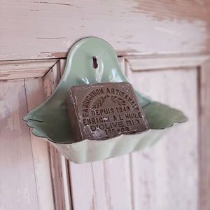 "Perfect for small farmhouse bathrooms that lack counter space, our Vintage Green Enamel Soap Dish is inspired by flea market finds. It also makes a great sponge holder to keep by the kitchen sink. Features an aged enamel style finish, which gives this piece a time-worn feel. Mount one in an outdoor shower for a vintage summer cottage feel. Can also be used on a countertop. (soap and hardware not included) 6""L x 3.5""W x 4.5""H"