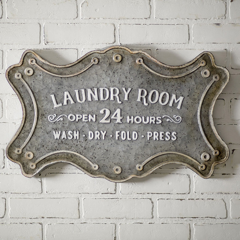 "Our Vintage Laundry Room Sign let's this be known with this with ""Open 24 hours"" in old style graphics. The aged metal and white lettering add an antique farmhouse feel."