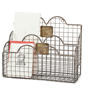 "Our Vintage Wire Mail Caddy features brass signs that read ""Letters In"" and ""Letters Out."" Has two compartments that fit books, letters and any standard size envelope. Features two rings on the back for hanging. 11''W x 4¾''D x 8½''H"