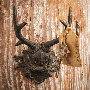 "This Antler Hook with Acorn Detail brings vintage cabin style to any room.  Features a dark metal finish with an acorn and leaf design. A fresh twist on rustic lodge decor, this antler hook makes a great wall accent for any room and is perfect for hats, leashes and more. (hardware not included.) 3""L x 2""W x 4.5""H"