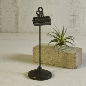 Industrial style clips are given a leg up on display when mounted on cast iron bases. Our Vintage Style Bookkeepers Clip on Stand is perfect for photos, a menu, a memo, or to hold table numbers at a reception. This vintage style clip has a perfectly aged patina and can be used in so many ways.  3.5x3.5x10.5
