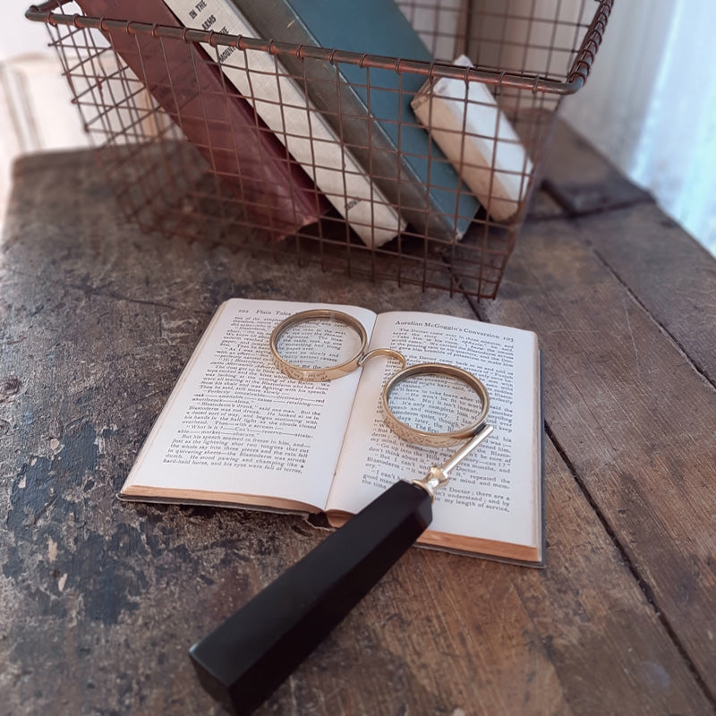 "You won't miss the fine print with these Vintage Style Magnifying Glasses. They make  the perfect little helper in addition to adding an old-fashion feel to your home office.  5.25""W x 7.25""H"