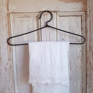 "Add a vintage touch to your laundry room or entryway coat closet with this Vintage Style Wire Hanger. The antique industrial feel of this sturdy wire clothes hanger offers a nostalgic twist on this basic staple of every day farmhouse living. 14.5""L x 6""H"