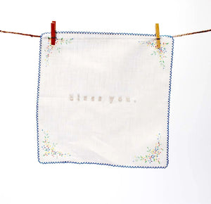 "Beautiful embroidered hankies were once a cherished item. We're bringing them back in style. These sweet vintage hankies are all lovingly collected by the artist from flea markets and antique shops and then embroidered with the words ""bless  you"" in tone on tone white. Because they are vintage hankies, no two are alike: some are linen, some are cotton"