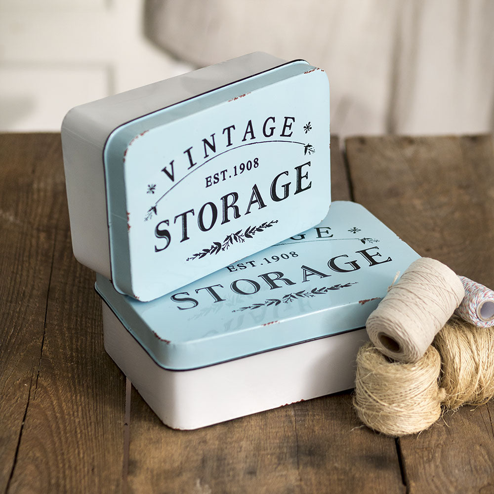 hese generously-sized tins offer perfect storage solutions for any room in your farmhouse. Set of 2 storage tins made of metal. Items nest together for easy storage.
