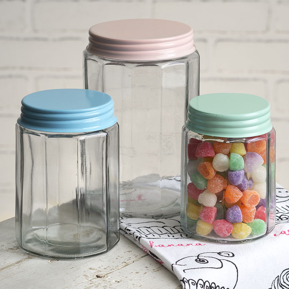 Our Vintage Jars with Pastel Lids makes farmhouse style storage a snap. The set of three multi-sided glass jars can be used in a variety of spaces to store or display your smaller items.