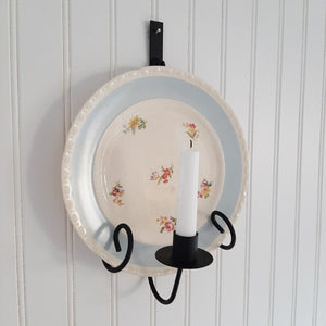 Instead of keeping those beautiful vintage dishes stashed away, put them on display with our Taper Candle Sconce and Plate Holder. This vintage style metal dish display makes it easy to show off your favorite floral plates. Use a vintage style mirror to create a warm glowing reflection with the candle. The primitive design of this wall mounted plate rack with candle holder is inspired by colonial candle plates and fits right in to farmhouse style decor.