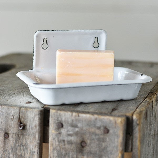 "Perfect for small farmhouse bathrooms that lack counter space, our Vintage Style Wall Mounted Soap Dish is inspired by flea market finds. It also makes a great sponge holder to keep by the kitchen sink. Features an aged enamel style finish, which gives this piece a time-worn feel. Mount one in an outdoor shower for a vintage summer cottage feel. (soap and hardware not included) 6""L x 4""W x 3""H"