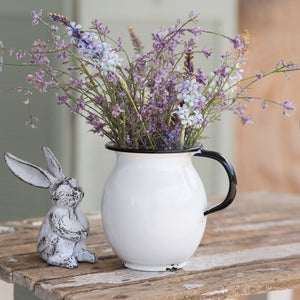 Our Cast Iron Long Eared Bunny makes a sweet accent. It's aged finish and adorable long ears make him the perfect addition to any shelf or tabletop. This little bunny brings charming whimsy to your spring and Easter décor. Show with White Enamel Pitcher with Vintage Style, sold separately