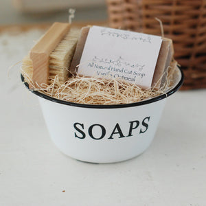 Our White Enamel Soap Bowl has a nostalgic quality that's perfect for a vintage style bathroom or guest room. The distressed white enamelware with black trim is classic farmhouse style. (Soaps and Brush Not Included.)